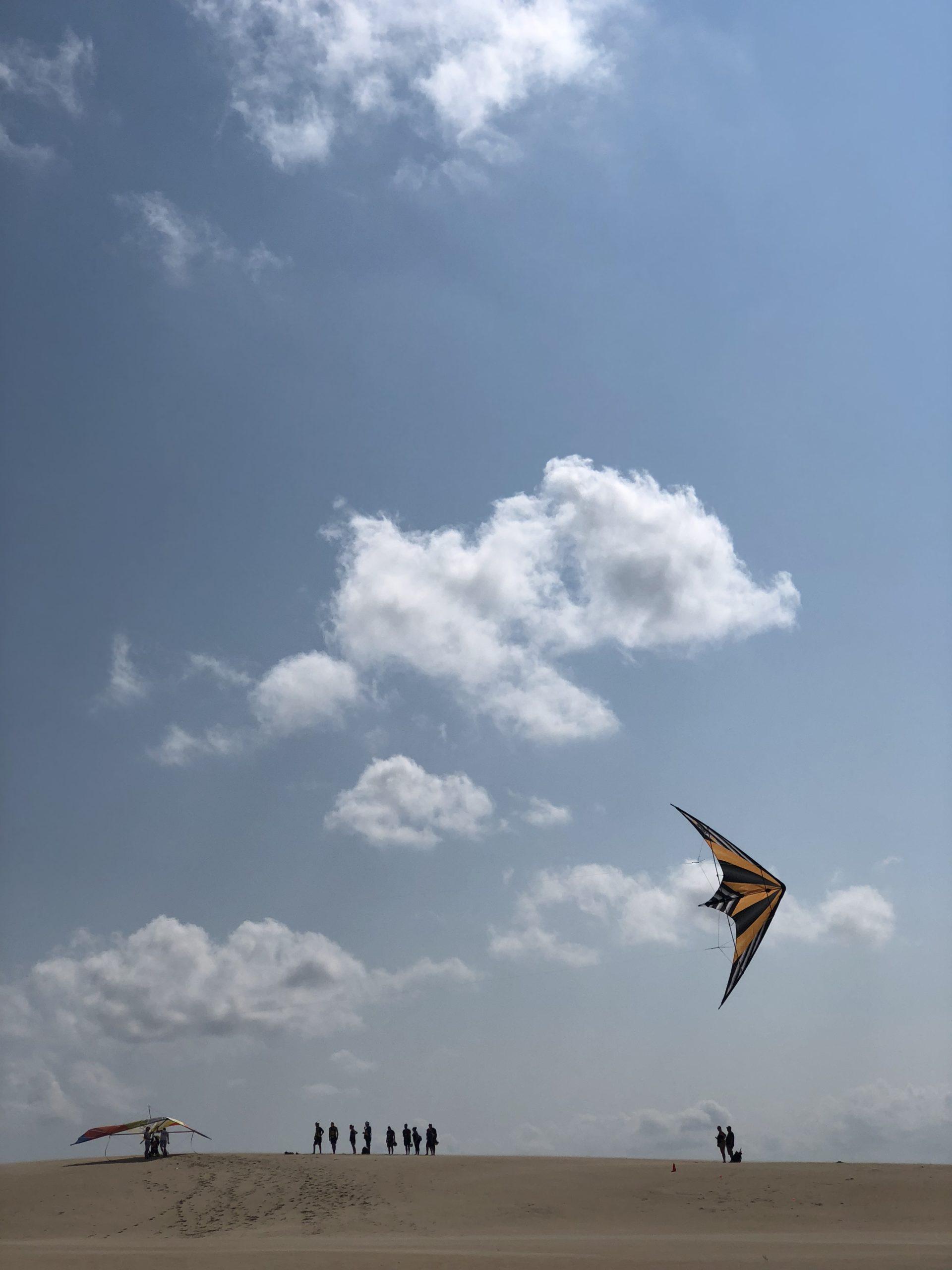 Flying a dual line stunt kite at Jockeys Ridge State Park